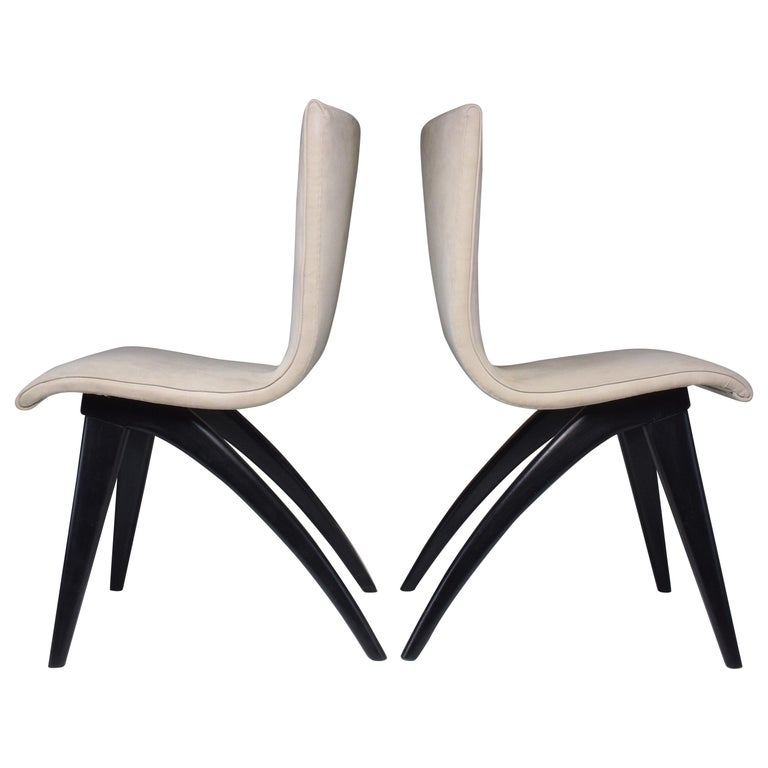 20th century vintage set of four swing curved and high back fully restored dining chairs from Netherlands, circa 1950s manufactured by C.J Van Os Culemborg.  The structure is composed of carefully lacquered beech splayed and tapered legs and the