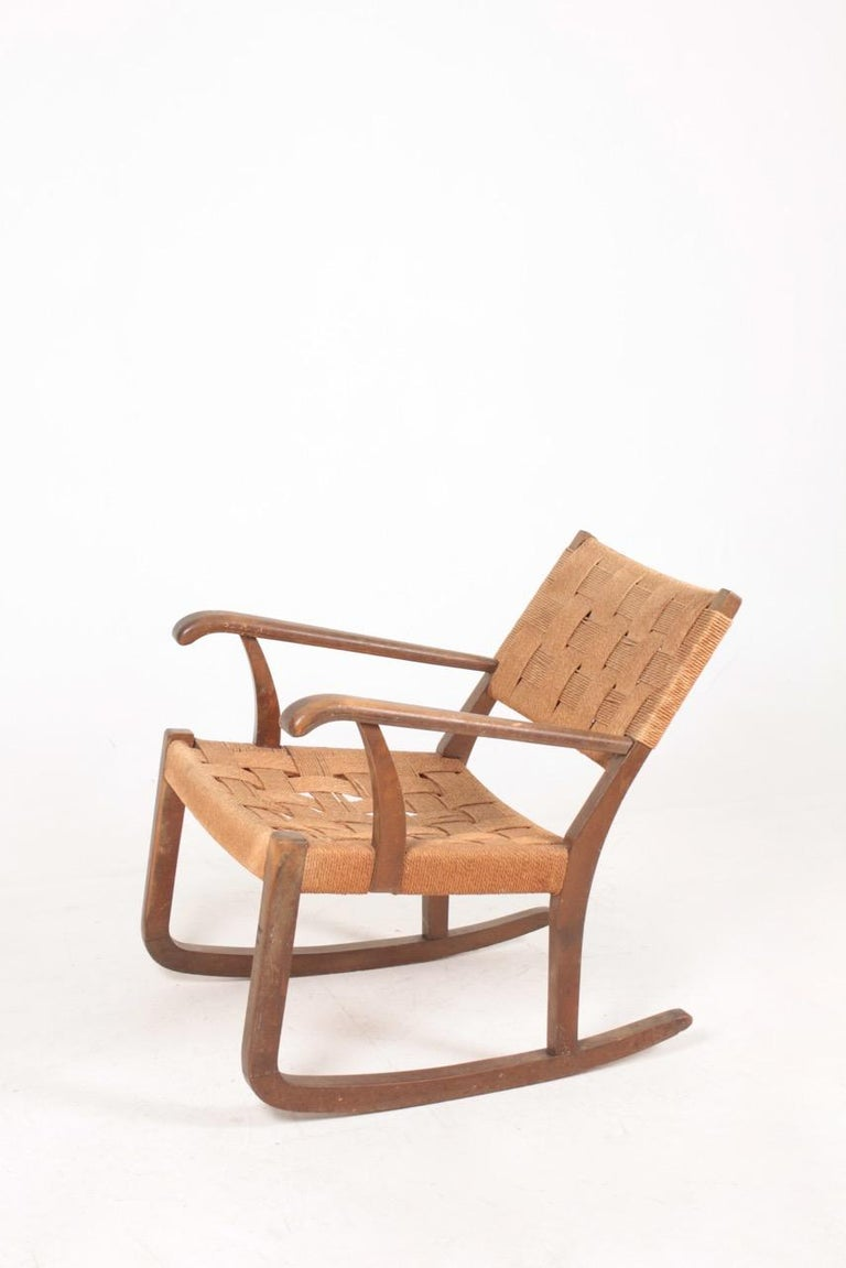 Very comfortable rocking chair, designed and made by Fritz Hansen.