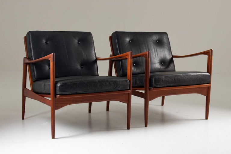 A rare seating group consisting of three lounge chairs and one sofa, model