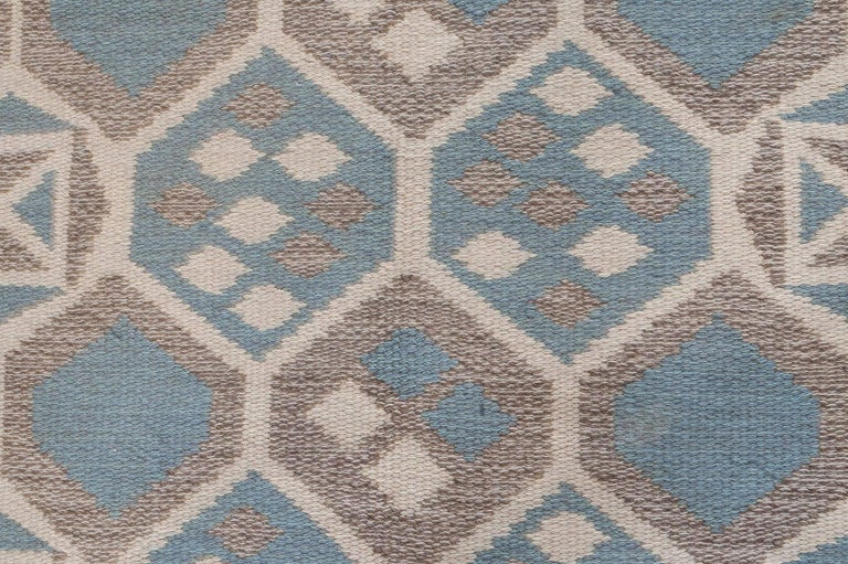Midcentury Scandinavian wool rug with honeycomb design in blue-grey, ivory, and brown