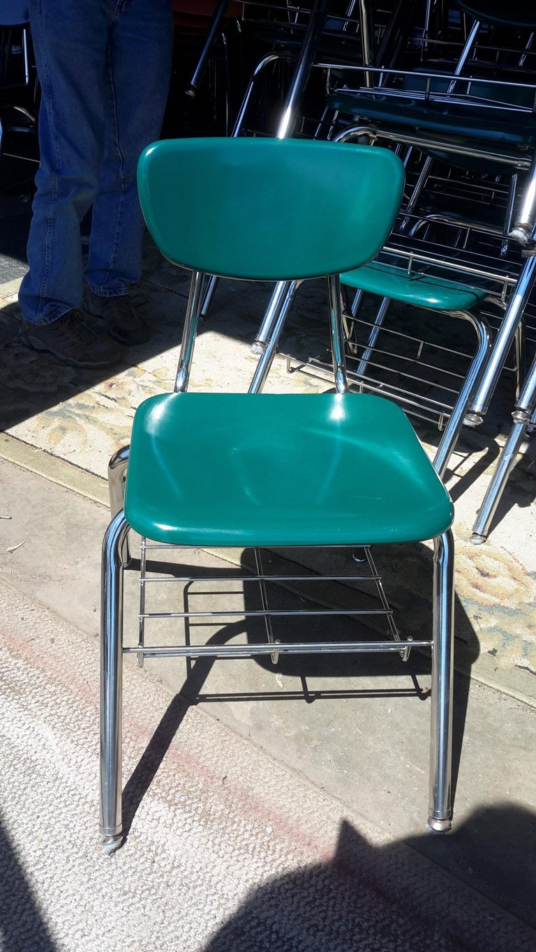 Midcentury glossy green fiberglass school chair in adult-size with chrome book basket (for purses, laptops, backpacks). Virco brand. Very good to excellent vintage condition. Great for home, office, restaurants, bars, coffee shops, events, weddings