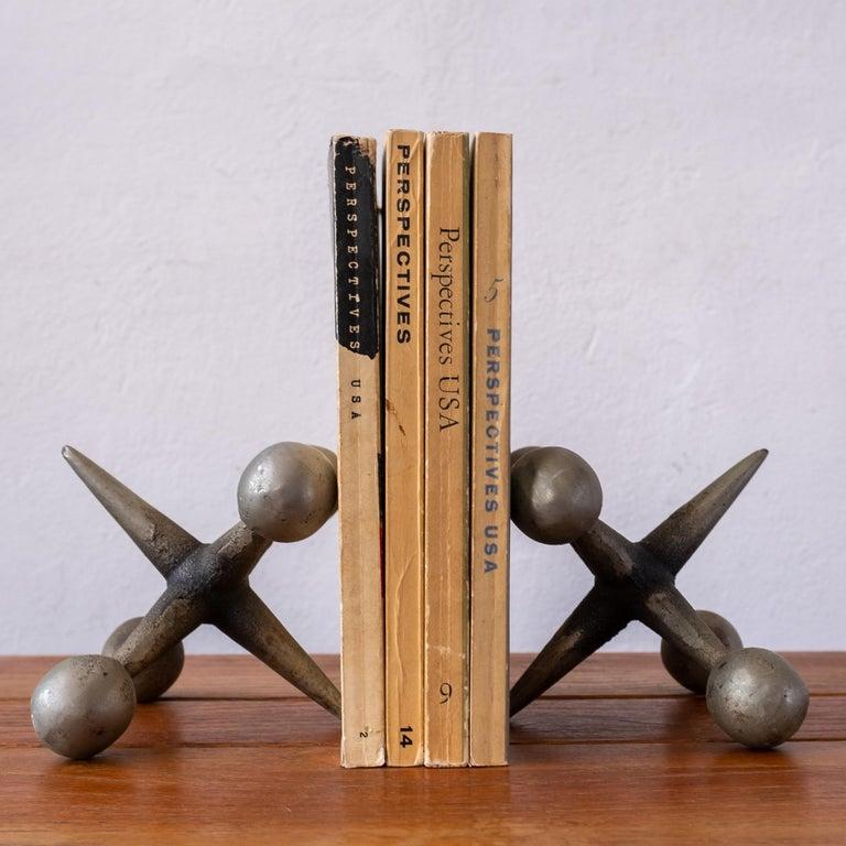 Solid metal sculptural jacks bookends. Great patina! 1950s
