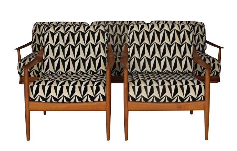 Wonderful classic and cosy Mid-Century Seating Group by Walter Knoll.   The group consists of two armchairs and one bench/sofa.   Being built in the 1950s in Germany, this group is made of teak solid wood and has been slightly overpolished by us.