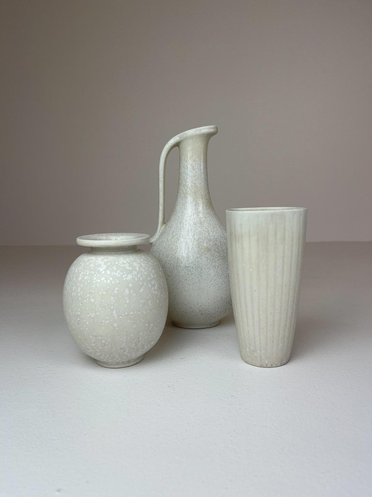 Three wonderful pieces, three vases from Rörstrand and maker, designer Gunnar Nylund. Made in Sweden in the midcentury. Exceptional glazed vases with wonderful curves. This set of three are rare to come by.   Good condition.   The last picture