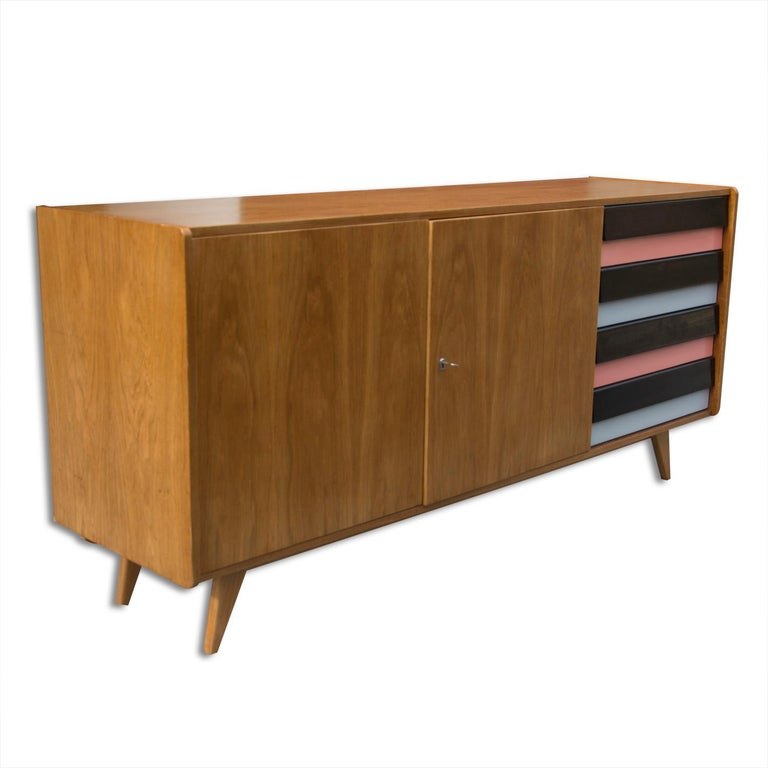 This is a vintage midcentury Czechoslovak sideboard, model number U-460. It was made in the 1960s and produced by Interier Praha. This model is associated with the world-renowned EXPO 58 and Brussels period. It features a four plastic colored