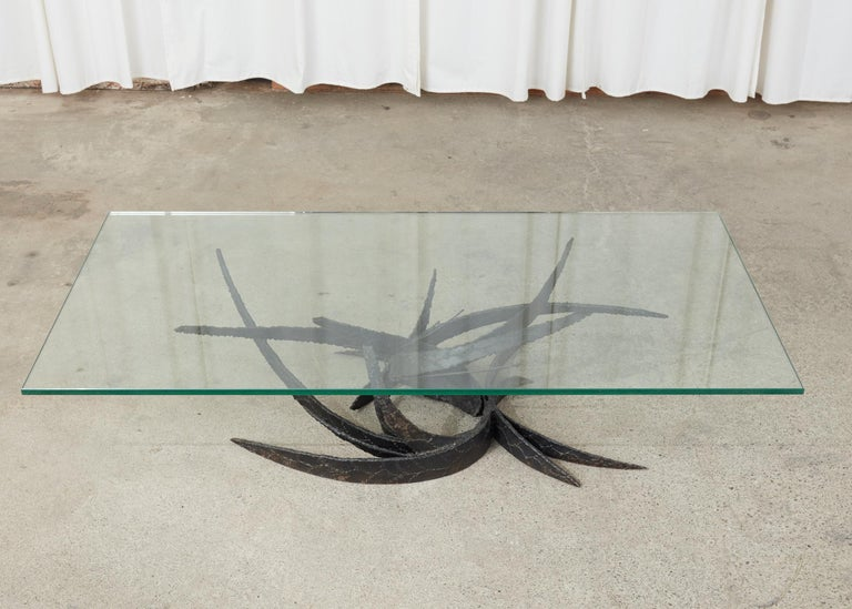 Fantastic Mid-Century Modern coffee cocktail table crafted from thick torch-cut iron in the brutalist style by Silas Seandel. The base measures 50 inches by 30 inches wide and features a biomorphic organic form sculpture. The treated metal has a