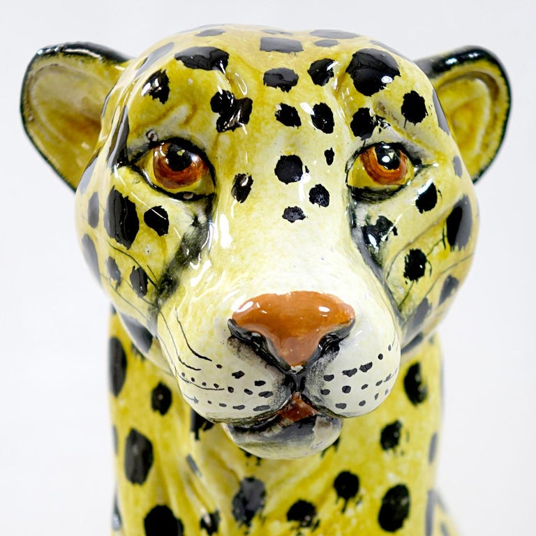 This is a very elegantly shaped sitting cheetah that was molded and not cast as most of the animal figurines from the midcentury period. Hand painted. With its height of 62cm (24.4 inches) it is both perfect on the ground as in a bay window. Marked