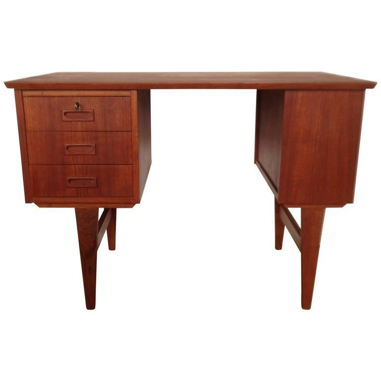 Lovely little Danish midcentury teak desk, with three drawers, one shelf on the side and one on the back.