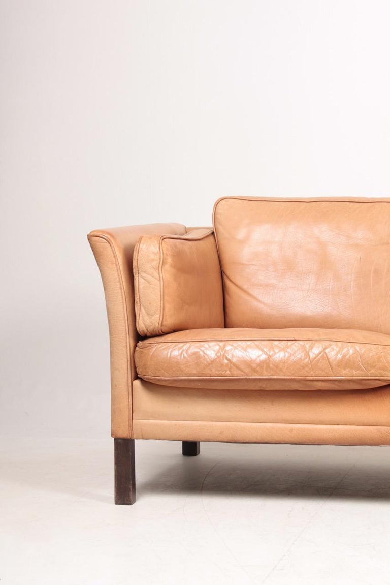 Three-seat sofa in patinated leather designed by Mogens Hansen in the 1980s. Great original condition. Made in Denmark.