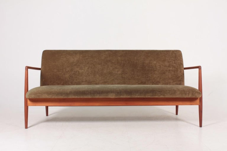 Sofa in oil finished teak and velvet. Designed and made by cabinetmaker C.B. Hansen. Great condition.