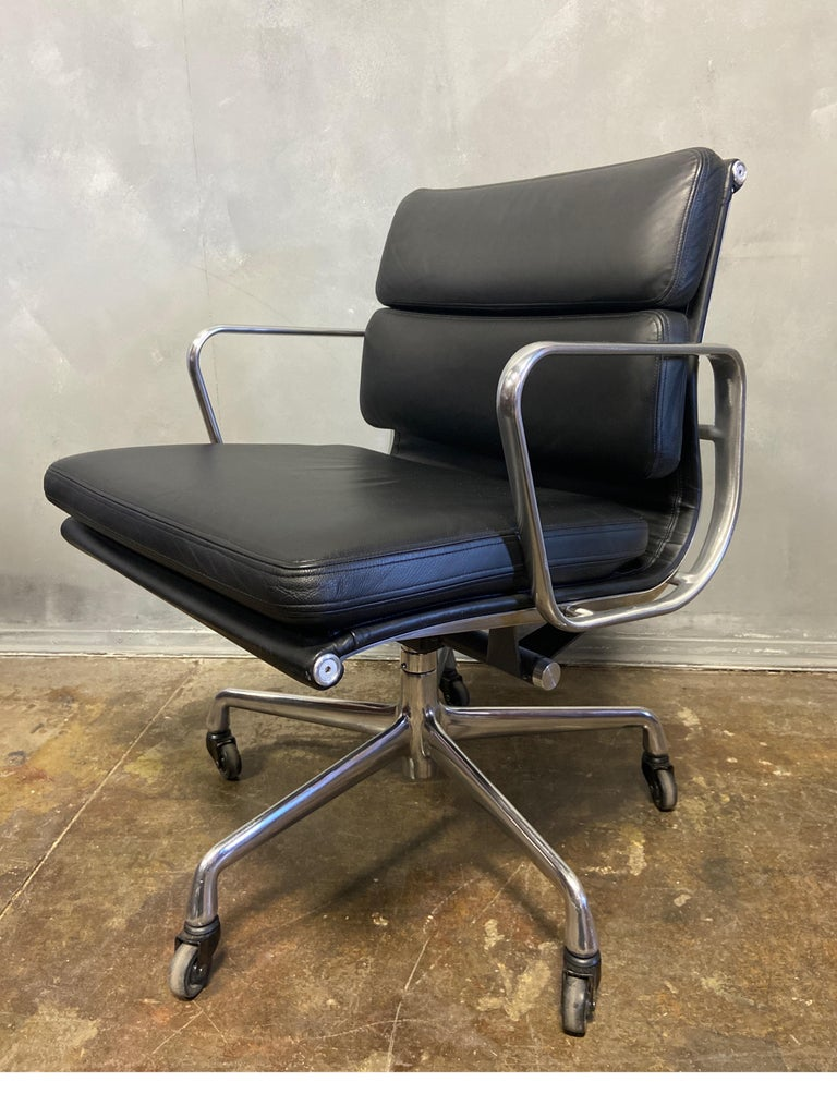 For your consideration is this authentic Eames for Herman Miller vintage soft pad chair in black leather in exceptional good vintage condition. Adjustable tilt and height. These authentic vintage examples are icons of Mid-Century Modern design. The