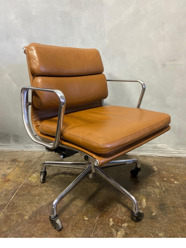 For your consideration is this authentic Eames for Herman Miller vintage soft pad chairs in Brown leather. Adjustable tilt and height adjustment. These authentic vintage examples are icons of Mid-Century Modern design. These chairs are part of the