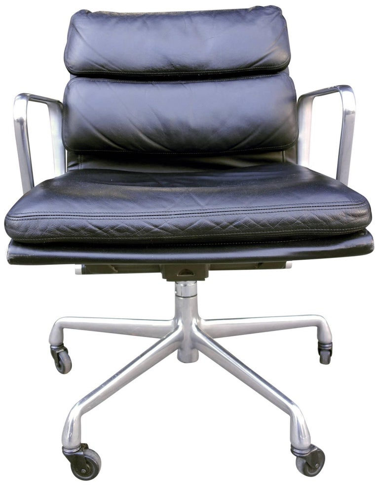 For your consideration are these Eames for Herman Miller vintage soft pad chairs in black leather with low backs.   These authentic vintage examples are icons of Mid-Century Modern design. The chairs part of the Eames aluminium group designed for