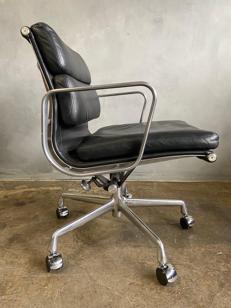 For your consideration we have up to 50 Eames for Herman Miller Soft Pad chairs in black leather with low backs.  These authentic vintage examples are icons of Mid-Century Modern design. The chairs part of the Eames aluminium group designed for