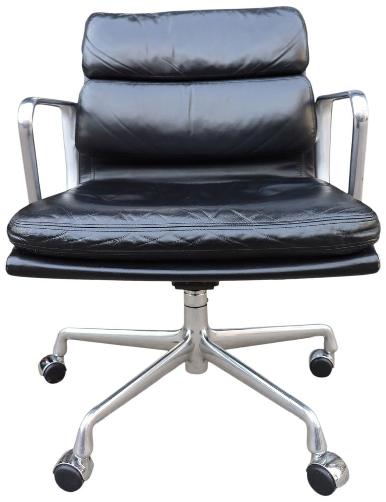 For your consideration we have up to 50 Eames for Herman Miller soft pad chairs in black leather with low backs. Manual height and tilt with 5 star base  These authentic vintage examples are icons of Mid-Century Modern design. The chairs part of the