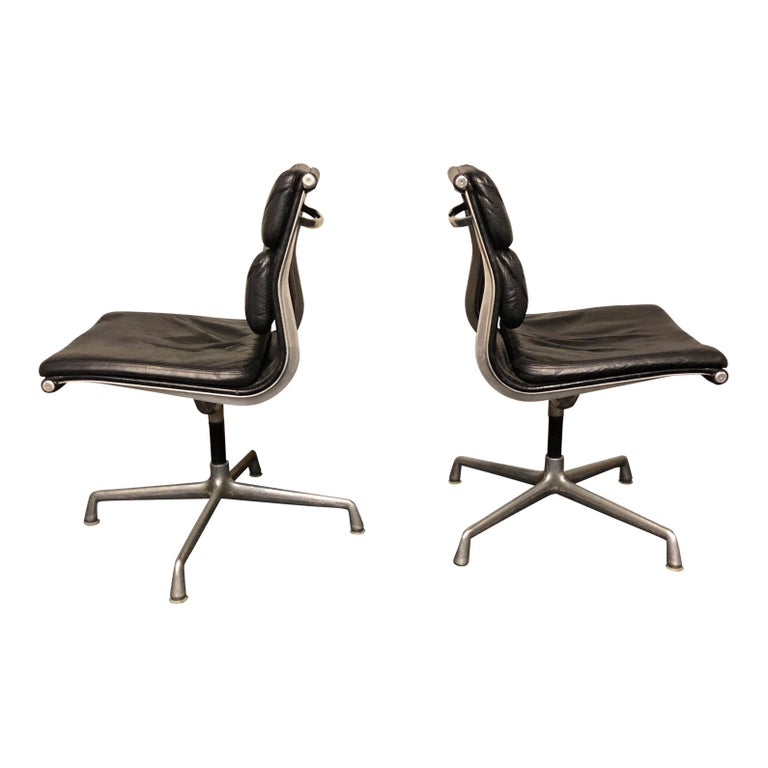 For your consideration are authentic Eames for Herman Miller vintage soft pad chairs in black leather.   These authentic vintage examples are icons of Mid-Century Modern design. The chairs part of the Eames aluminium group designed for Herman
