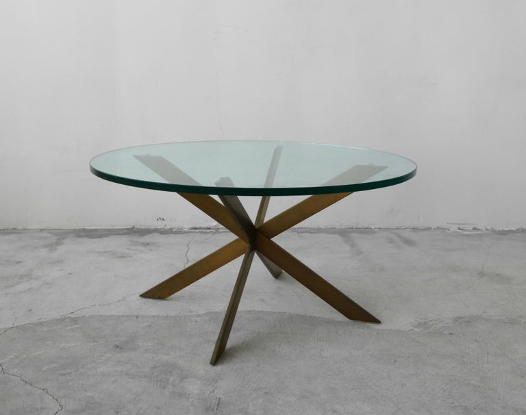 A beautiful solid bronze coffee table by Leon Rosen for base. Such a simple, yet modern and elegant piece. Base is solid bronze, weighing at least 40lbs.  Bronze has the most beautiful patina. Left as found, could be polished to bring it back to