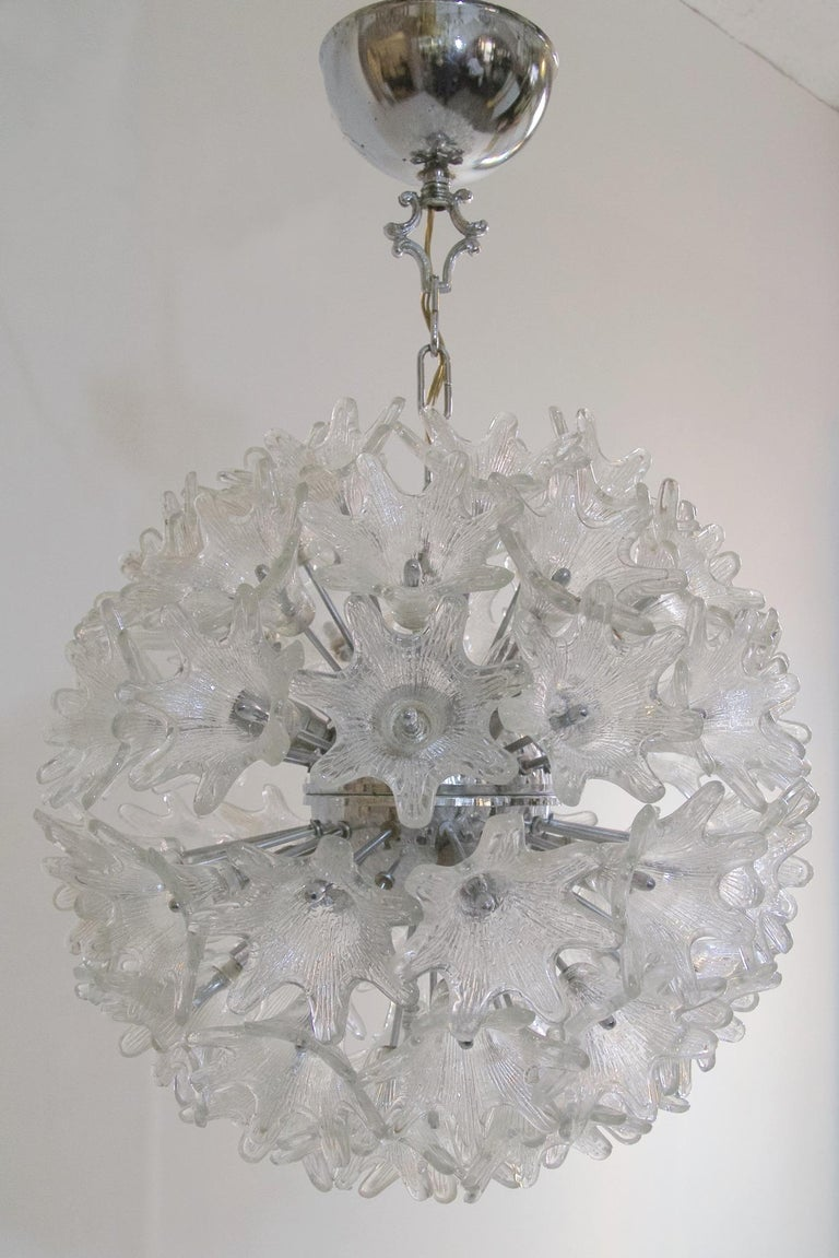 Large Murano Sputnik ball chandelier designed by Paolo Venini for VeArt Italy with clear glass flowers and a chrome structure. The lamp takes eight small Edison E14 bulbs.