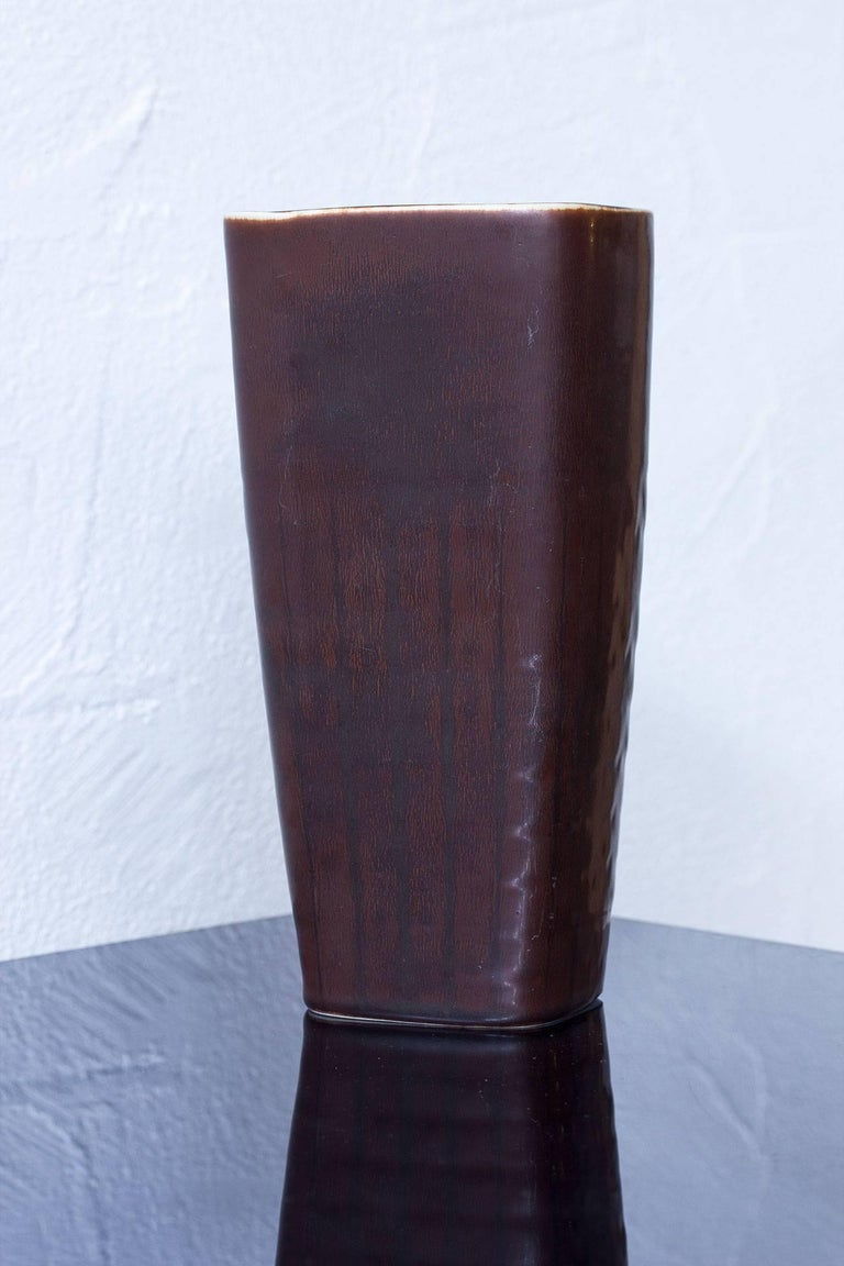 """Stoneware vase designed by Carl-Harry Stålhane for Rörstrand in a brown hare's fur glaze. Hand thrown in Sweden, during the 1950s. Hand signed """"R"""", three crowns of Rörstrand with initials of ceramist."""