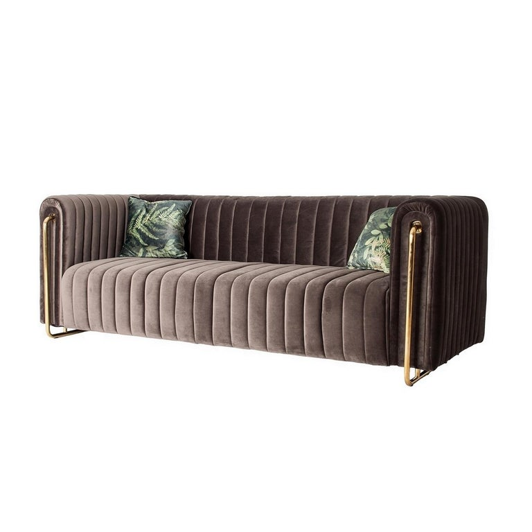 Gilded metal feet and graphic velvet soft and comfy sofa (jungle pillows include).