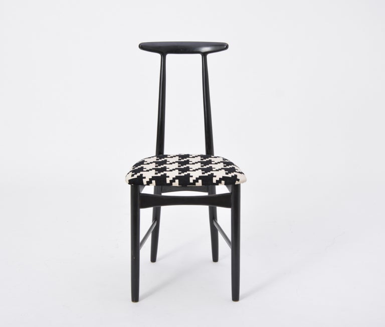 Swedish Mid-Century Modern chair by Gemla Diö  This chair was produced by Gemla Diö in Sweden, circa the 1950s. The frame is made of black-lacquered wood and the chair has been newly reupholstered.