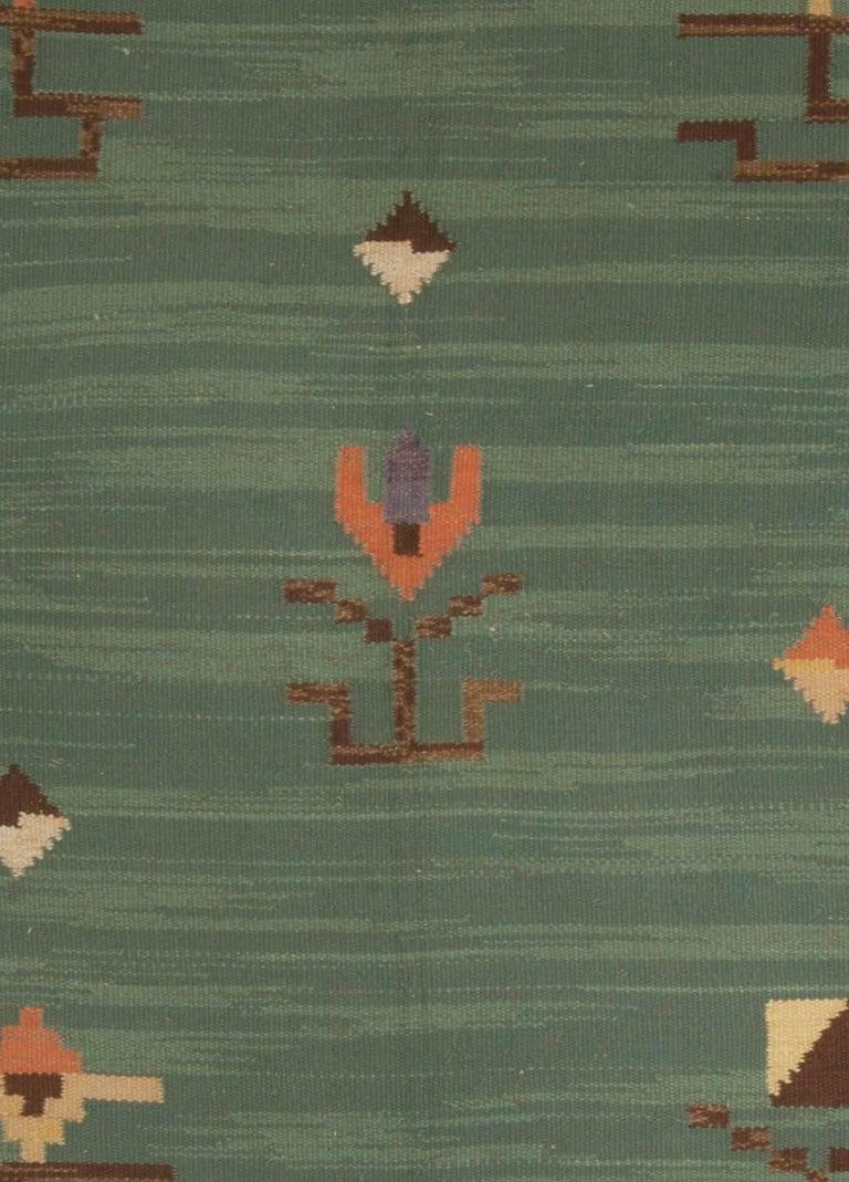 Midcentury Swedish green handwoven wool rug Size: 10'6