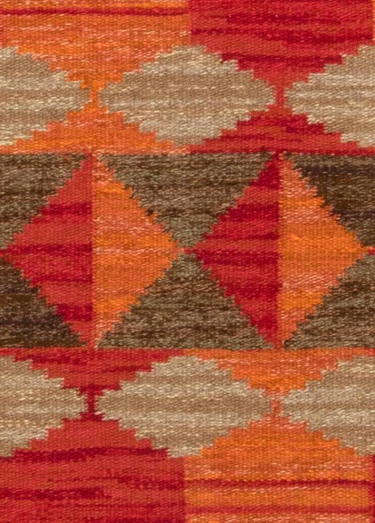 Midcentury Swedish red, orange and brown flat-woven rug by Karin Jönsson 'Klockargården Hemslöjd' Size: 5'0