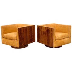 Mid Century Swivel Lounge Chairs by Milo Baughman in Rosewood and Cognac Leather