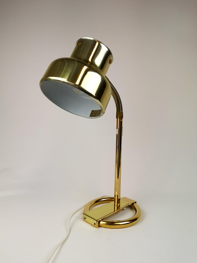 This 1960s table lamp, model Bumling, was designed by Anders Pehrson for Ateljé Lyktan in Åhus, Sweden. This table lamp with its brass featuers is a nice edition to your writing desk or small table.   Nice working vintage condition.  Measures: H