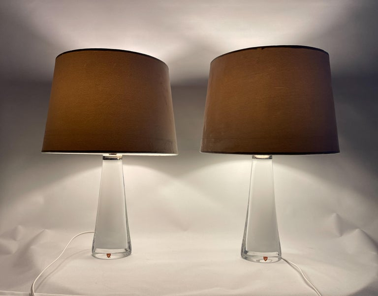 Table lamps in crystal, model RD 1566 by Carl Fagerlund for Orrefors, Sweden. The lamps have a white color with clear glass, and chrome details.  Good working vintage condition, rewired.  The shade can be included if buyer wants.   Measures: