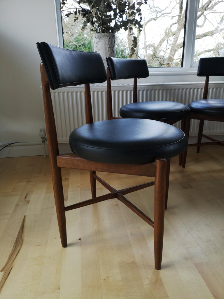 Midcentury Teak And Black Vinyl Dining Chairs By Victor