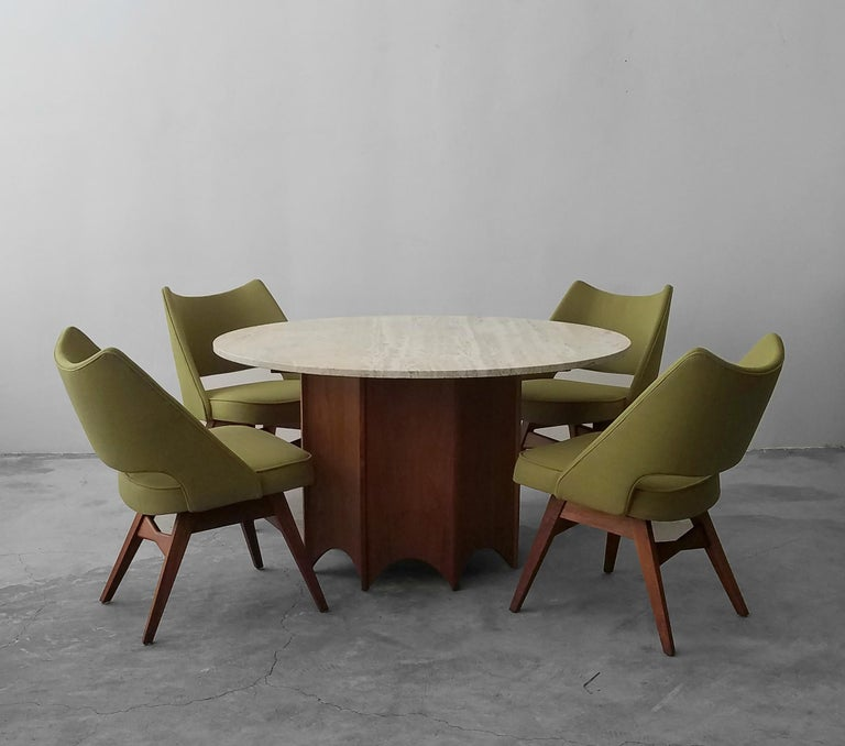 A beautiful Classic midcentury set. This gorgeous Travertine and walnut game table and chairs set by Harvey Probber is a must for any true midcentury enthusiast or anyone looking for a game table that has timeless class and style. The set includes