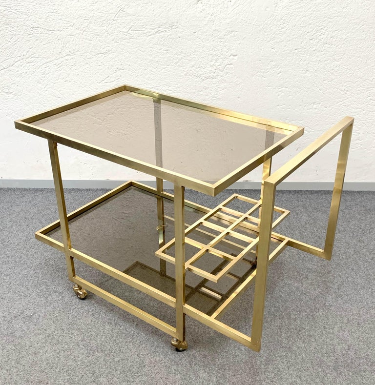 Italian Midcentury Two Levels Smoked Glass and Brass Bar Cart with Bottle Holder, 1970s For Sale