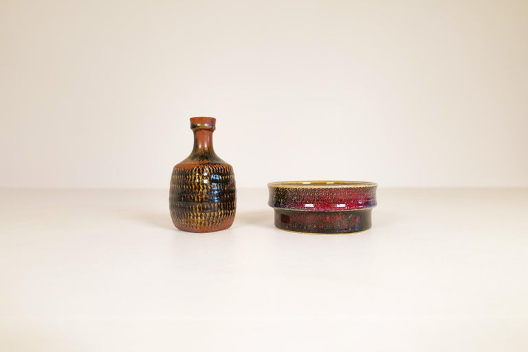 These two unique and wonderful sculptured ceramic pieces was made at Gustavberg Sweden during the 1960s and designed by famous Stig Lindberg. They both have Lindbergs signature engraved into the bottom of the ceramic together with the well-known