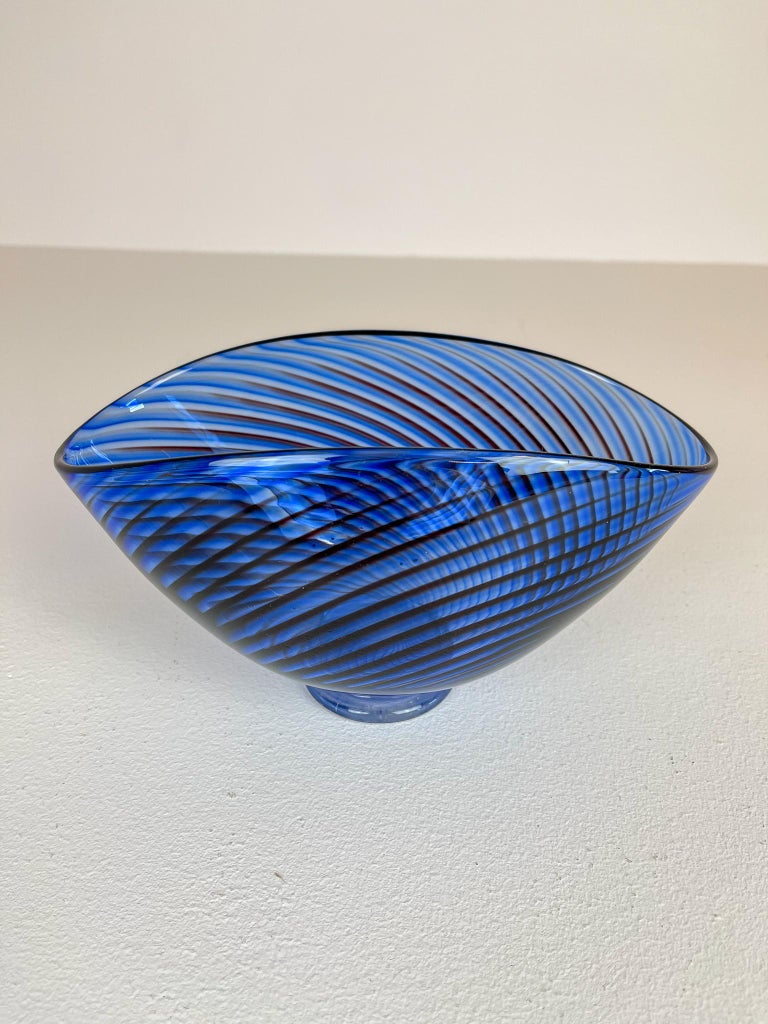 Wonderful blue checkered vase produced in Sweden at the Kosta factory. Designed by Vicke Lindstrand. This piece is a large version of the series Colora, it stands on a foot and have black lines checkered into the blue colored vase. Its beautifully