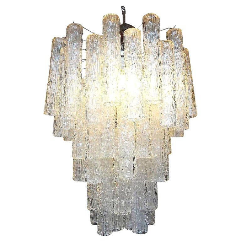 Large midcentury tubular Murano glass chandelier in the style of Venini, circa 1960. This Murano chandelier can be suspended from a chain if extra length is needed.