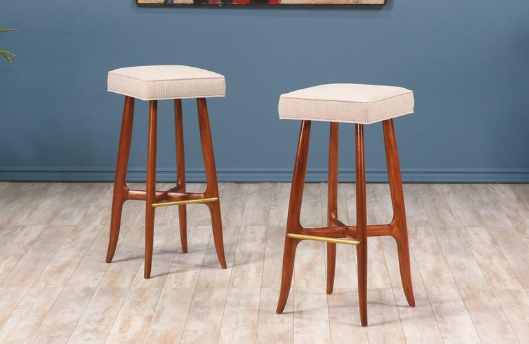 56fc8ef7fada19 Mid Century modern bar stools designed and manufactured in the United  States circa 1960's. A