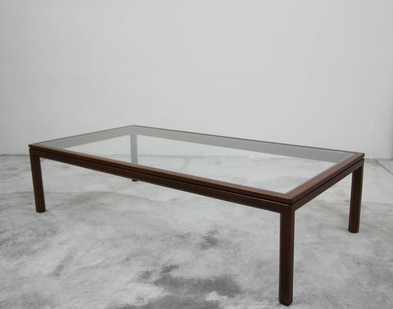Simple. Beautiful. The perfect Minimalist coffee table constructed of solid walnut and glass. Perfect in any space.