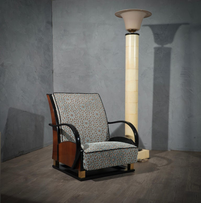 Very Italian style at the turn of the last century, exalting walnut wood combined with a very very elegant velvet. Very arched back for an unmistakable design.  The armchairs have a walnut wood structure, combined with black lacquered parts,