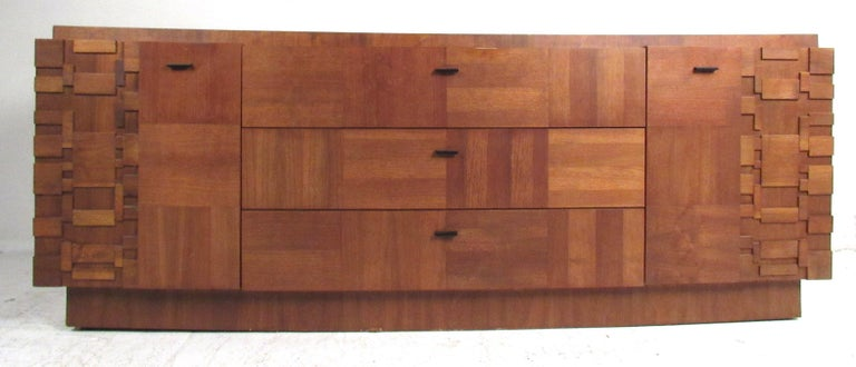 Dramatic five piece Brutalist bedroom set made in Canada, 1975. Dimensional patchwork design with a contrasting parquet style walnut construction makes a impressive Brutalist statement. Set consists of a tall wardrobe, a long low dresser with