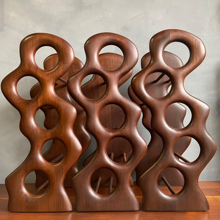 For your consideration are these beautifully sculpted wine racks by Master Craftsman Dean Santner. Santner designs are part of the American Modern Craft movement along side Wendell Castle, Nakashima, Phillip Powell to name a few. This hand sculpted