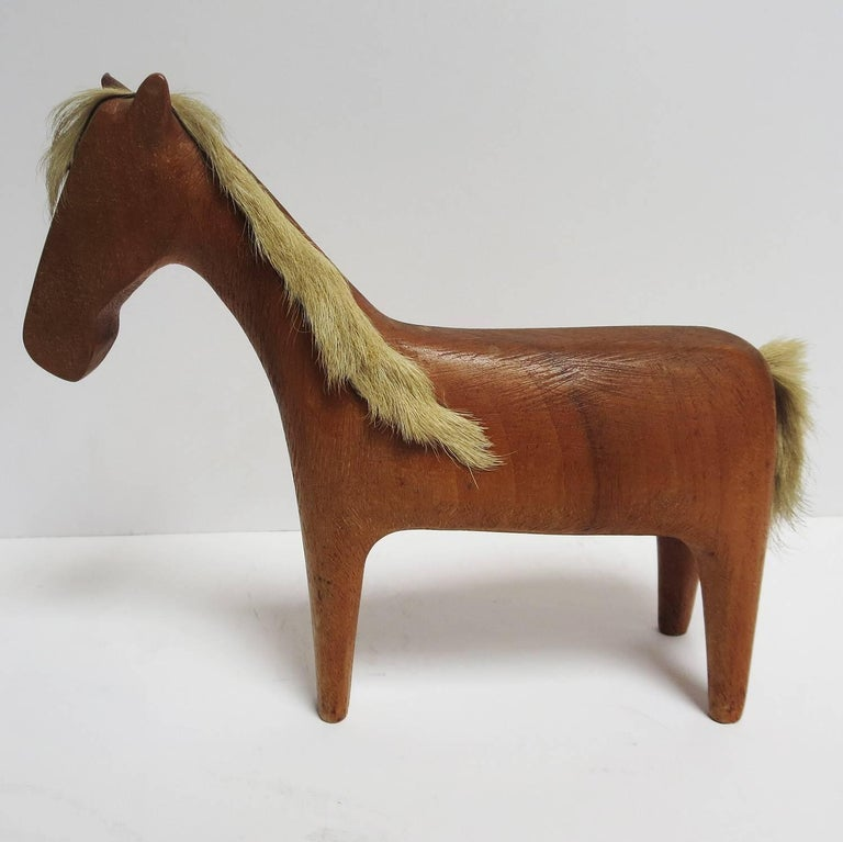 We have had many Hagenauer sculptures over the years, but have never seen a horse like this! The form is very stylized and minimal, typical of Hagenauers' work. He (or she) is completely made of wood, with the exception of the hair on the mane and