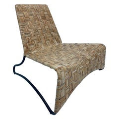 Midcentury Woven Rattan Lounge Chair with Black Tubular Frame