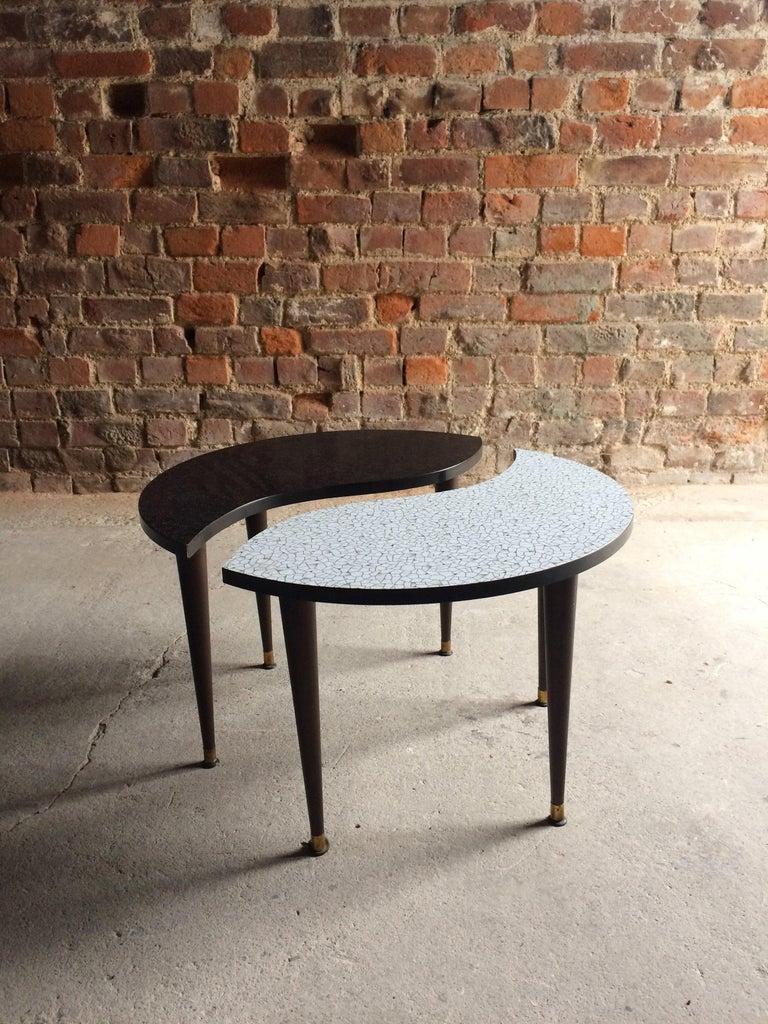 A magnificent and very beautiful Yin & Yang tripod occasional table, circa 1950s, the circular top showing both sides of Yin & Yang, the tables separate in two on tripod legs with brass ends.  Condition: This item is offered in excellent vintage