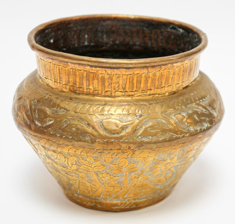 Middle Eastern Egyptian bowl hand-etched and hammered brass. Early 20th century Egyptian brass vessel bowl. Engraved and hand-chased repousse with Egyptian arabesque designs on brass vessel. Egyptian pyramids, birds and mythological Pharaonic