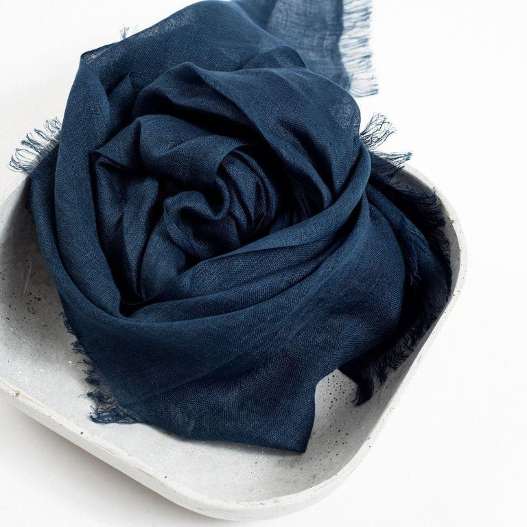 Custom design by Studio variously, midnight blue is a Classic scarf / wrap / shawl made in pure linen by master artisans in Nepal.  A sustainable design brand based out of Michigan, Studio Variously exclusively collaborates with artisan