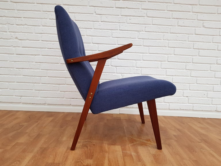 Scandinavian design, armchair. Produced in about 1960. Teakwood legs and armrests. Completely restored by craftsman, furniture upholsterer at Retro Møbler Galleri. Brand new padding with natural coconut mat. New reupholstered in quality blue