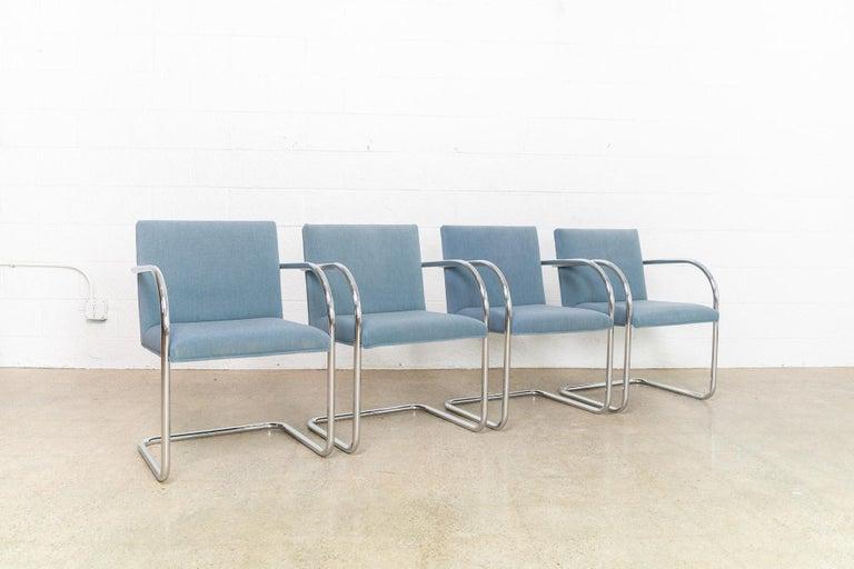 This set of four Mies van der Rohe Brno armchairs made by Gordon International are circa 1990. These iconic Mid-Century Modern chairs designed by Mies van der Rohe in 1930 feature clean lines and a simple profile. Model 504 features a cantilever