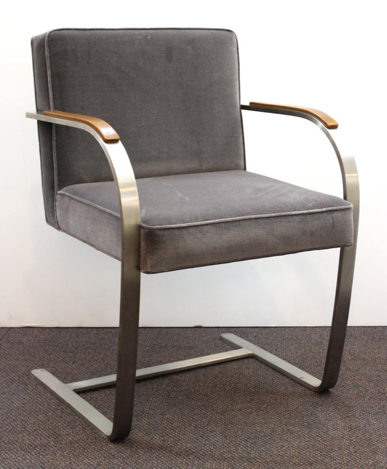 Modernist set of two polished steel armchairs with velvet upholstery and faux leather armrests, designed by Mies van der Rohe for Knoll in the 1960s. From the estate of the late Peter Knoll in New York City. The pair is in great vintage condition