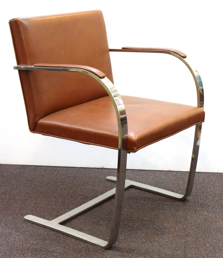 Modern set of three polished steel armchairs with leather upholstery, designed by Mies van der Rohe for Knoll in the 1960s. The set is in great vintage condition with age-appropriate wear to the leather.